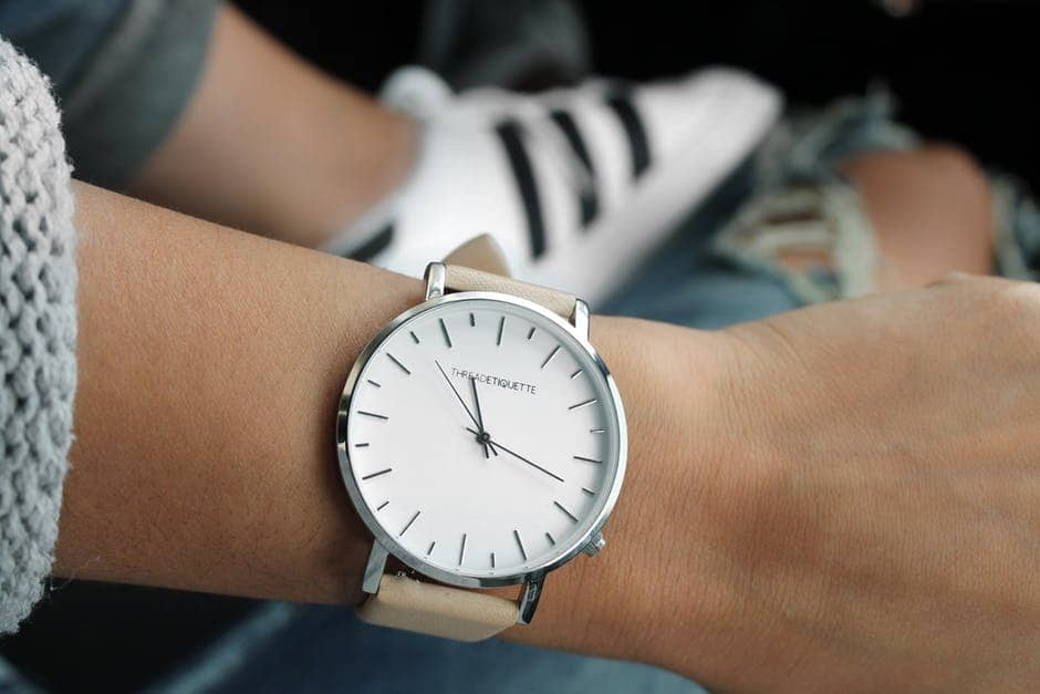 A close up of a clock in the middle of a watch